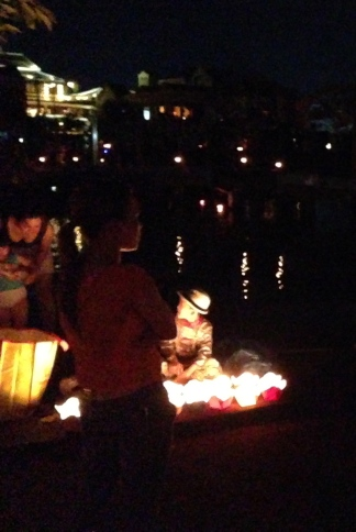 lowering paper lanterns on the full-moon festival